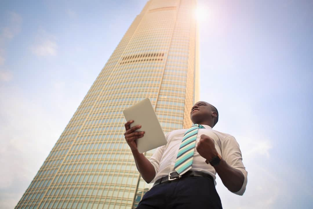 A man standing in front of a building